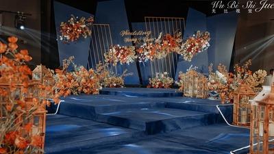 不规则色块与线条设计感的蓝橙撞色系婚礼